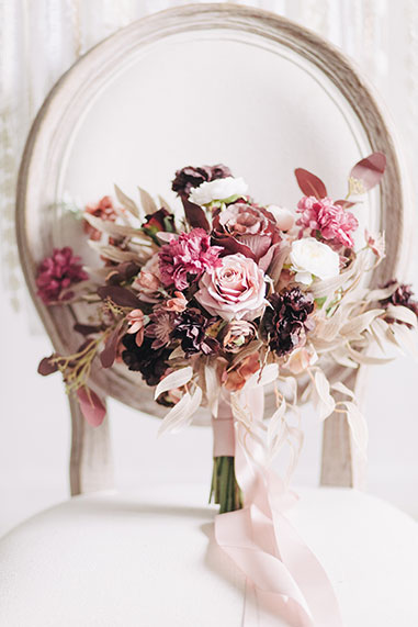 photo of bouquet on ceremony chair