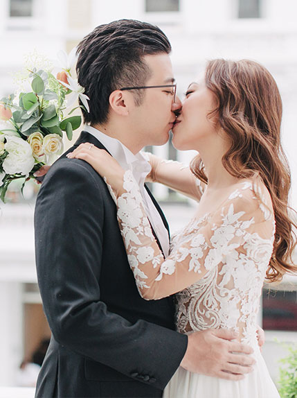 couple kissing during marriage