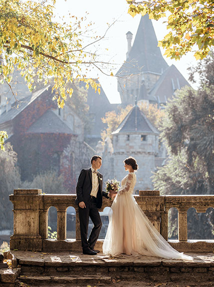 couple posing infront of church