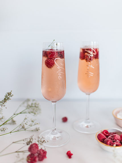 two champagne glasses on wedding table