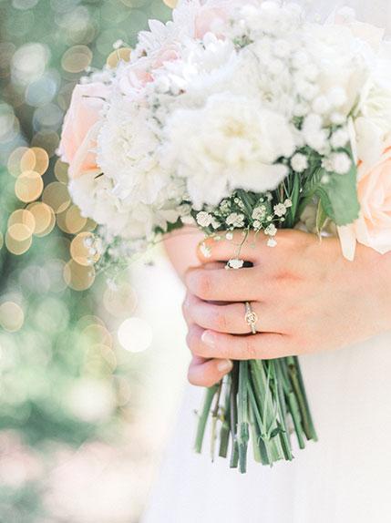 bride holds wedding flowers