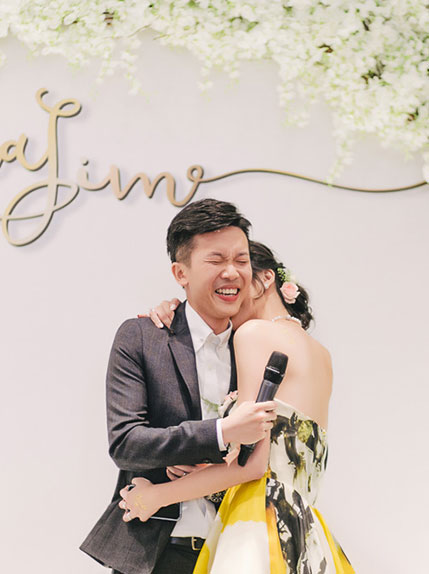 couple lauging at wedding venue