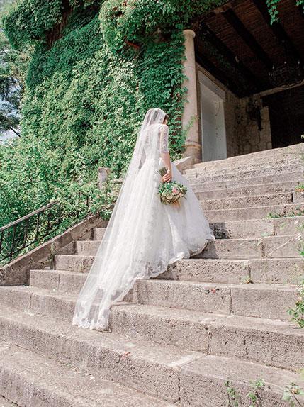 bride walks in beautiful wedding dress
