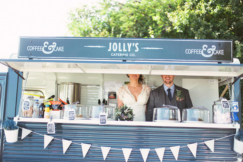 couple having photo taken in a food truck at a wedding