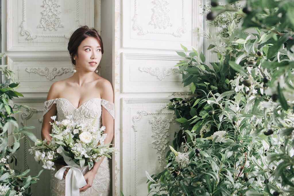bride poses in white wedding dress with bouquet