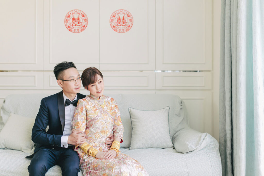 chinese bride and groom sitting during wedding morning