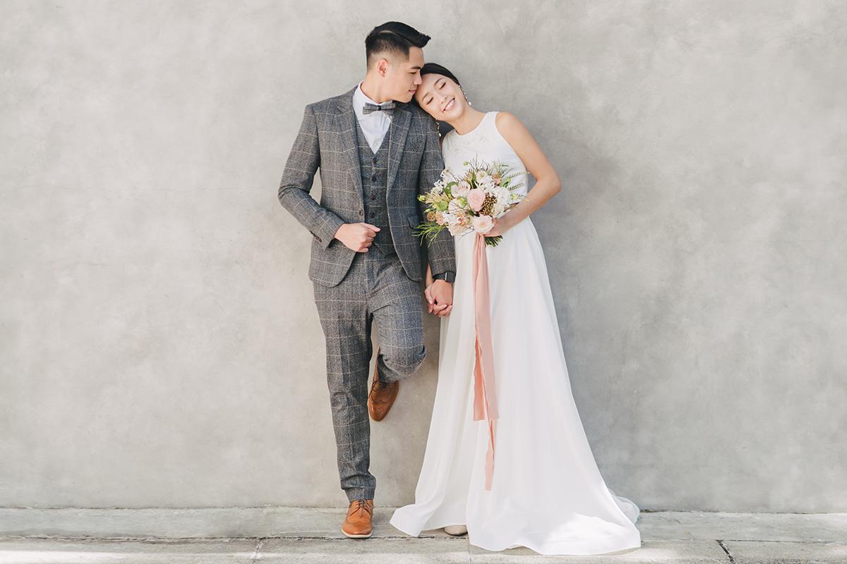 bride and groom posing in wedding clothing
