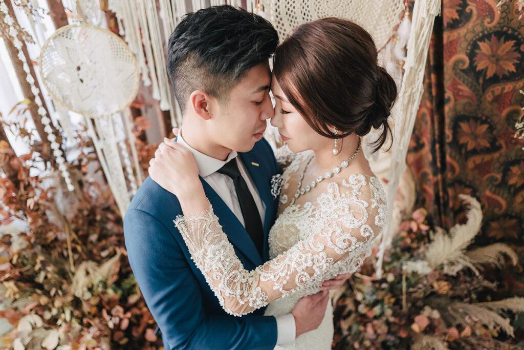 bride and groom kissing in wedding attire