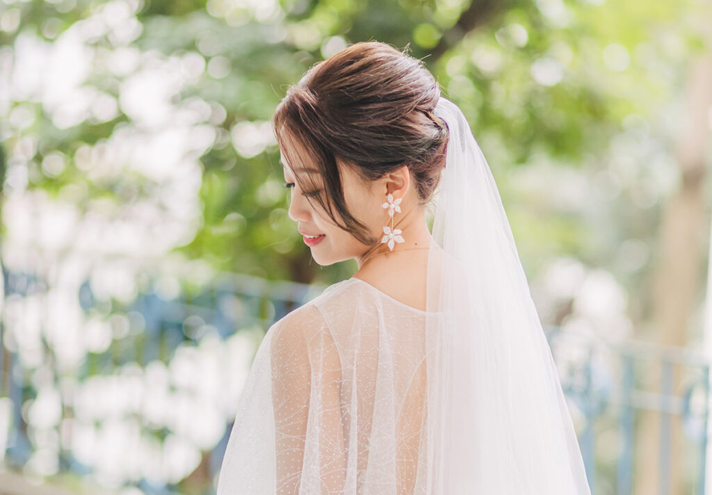 bride showing off wedding hairstyle