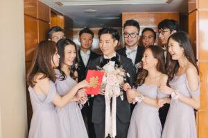 groom plays chinese door games during wedding