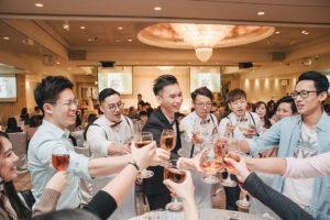 groom toasts during wedding at the langham hong kong
