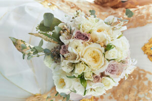 wedding bouquet rests on table