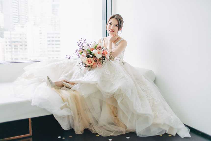 bride sits on bench at the murray hotel in hong kong